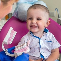 toddler with dental hygienist