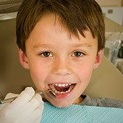 Kid receiving dental exam