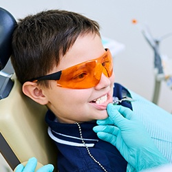 Dentist looking at child's smile