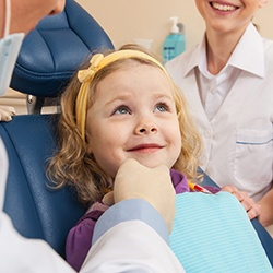 Smiling little girl in dental chair