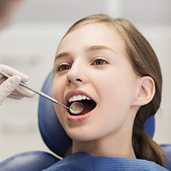 Girl receiving dental exam