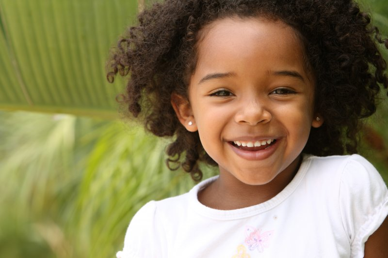 girl smiling after a frenectomy in Casper